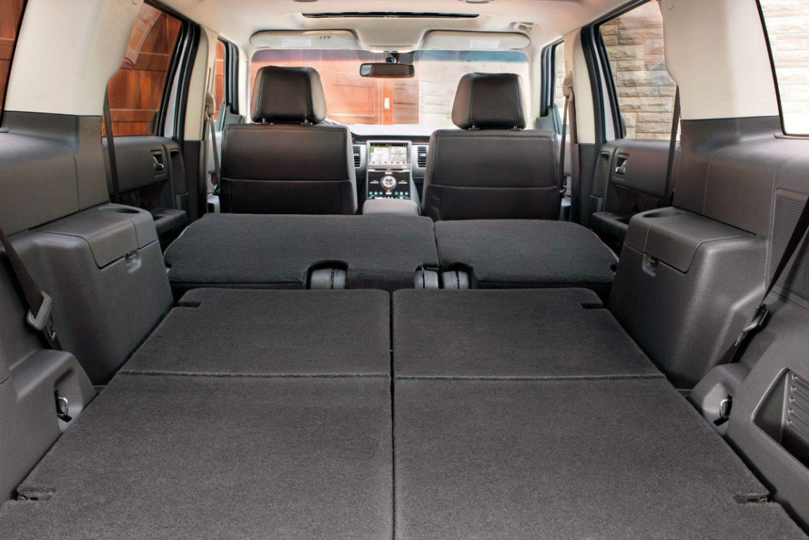 Rear seats folded flat for storage in the 2019 Ford Flex