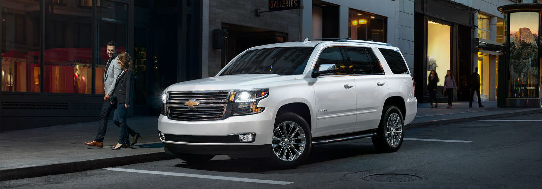 Driver side exterior view of a white 2019 Chevy Tahoe