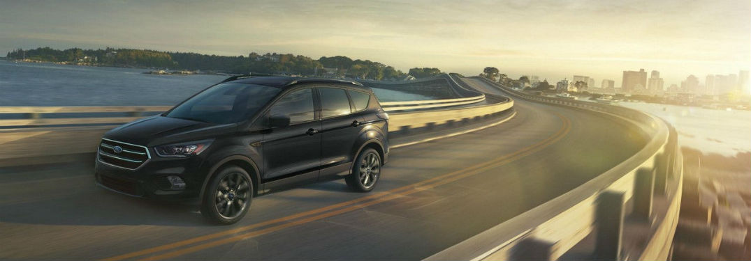 Driver side exterior view of a black 2018 Ford Escape