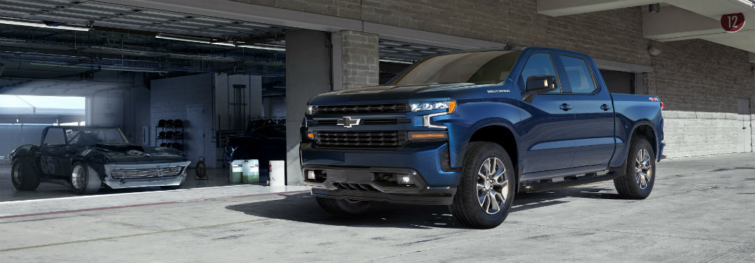 Front driver side exterior view of a blue 2019 Chevy Silverado