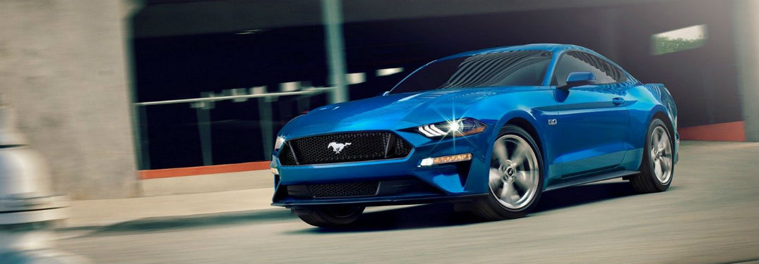 Driver side exterior view of a blue 2019 Ford Mustang