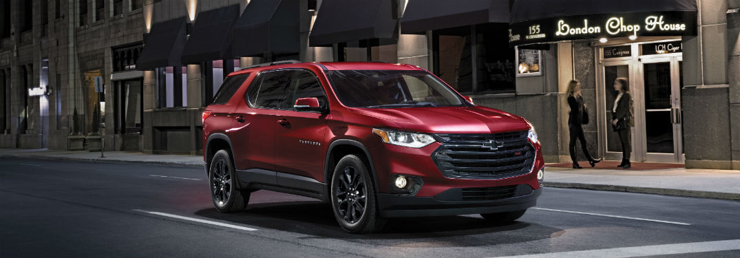 Front passenger side exterior view of a red 2019 Chevy Traverse
