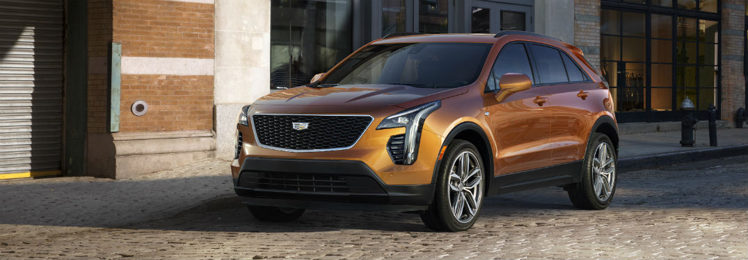 Front driver side exterior view of a bronze 2019 Cadillac XT4