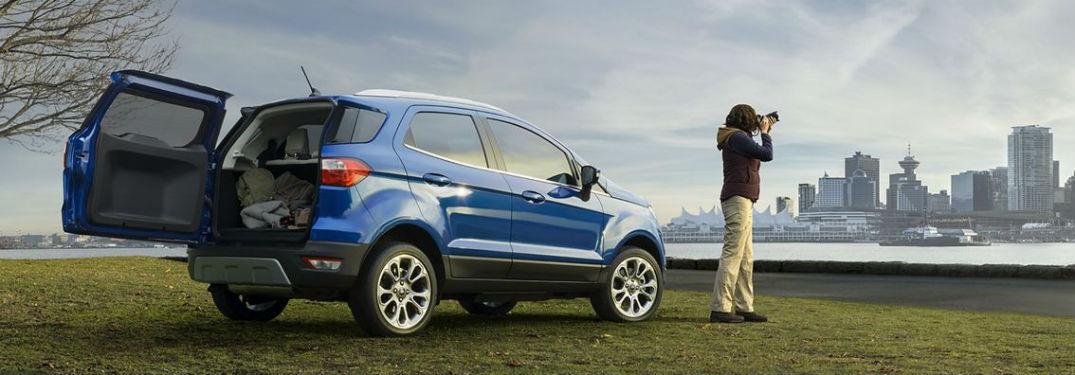 Rear passenger side exterior view of a blue 2019 Ford EcoSport with its rear swing gate open