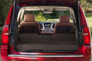 Rear two rows of seating folded flat for cargo storage in the 2019 Chevy Tahoe