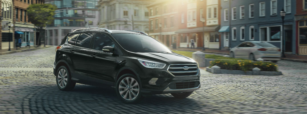 A front right quarter photo of the 2019 Ford Escape in a town square.