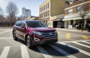 front view of red ford edge on city street