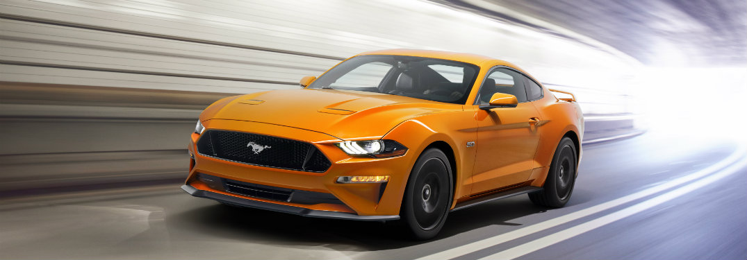 front view of orange ford mustang