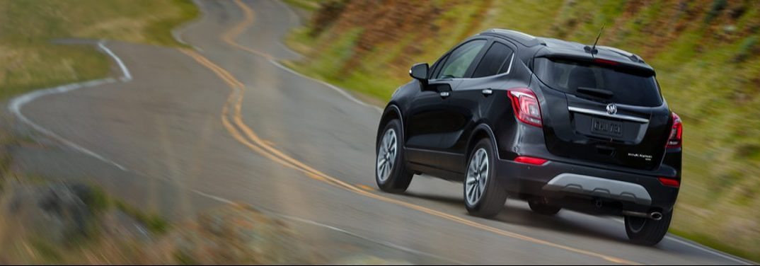 Black 2019 Buick Encore clings to the highway adeptly through the use of all-wheel drive.