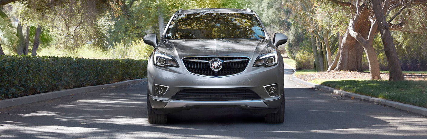 2020 Buick Envision on road with hedges from exterior front view