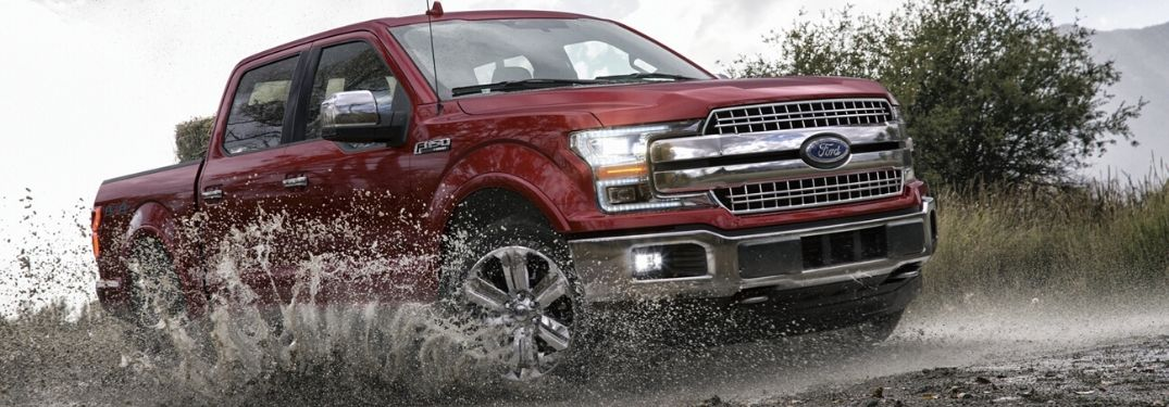 2020 Ford F-150 Lariat SuperCrew driving through mud