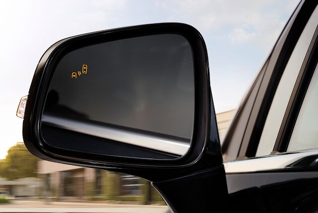 Side Blind Zone Alert shown on side mirror of 2020 Buick models