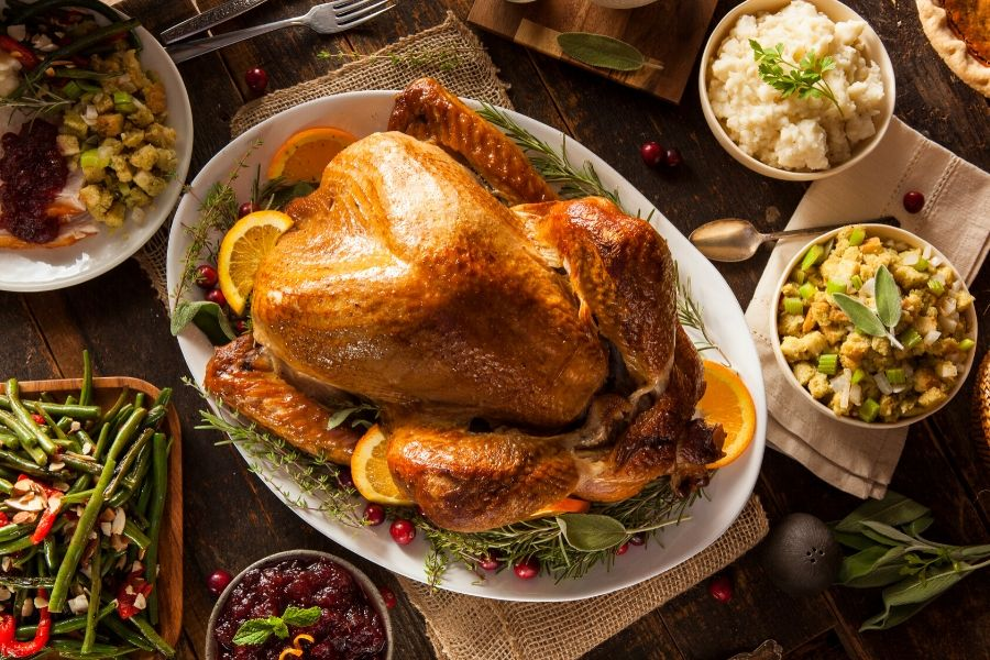 Thanksgiving turkey with side dishes on table