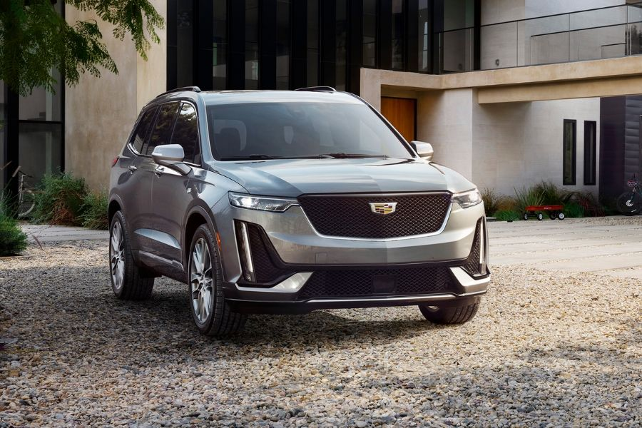 2020 Cadillac XT6 parked in front of a house from exterior front passenger side