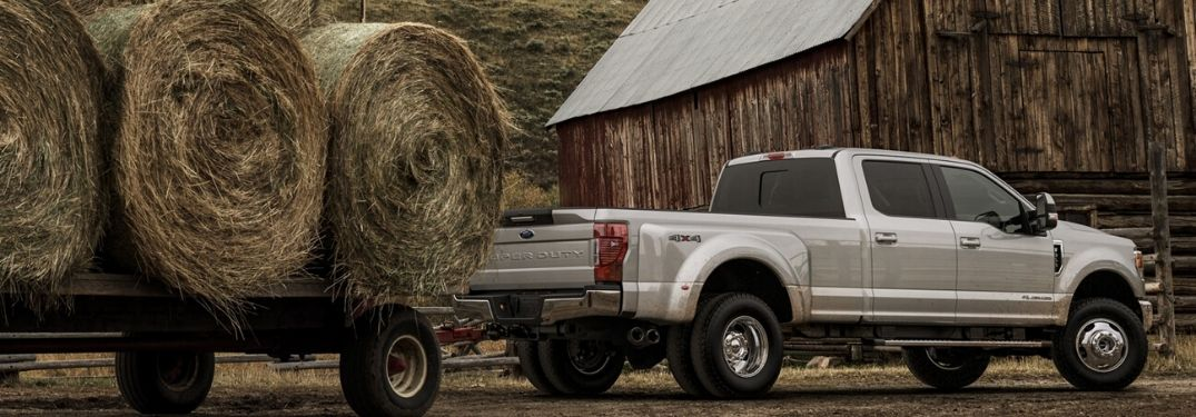 2020 Ford F-350 LARIAT towing hay on trailer