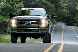 2020 Ford Super Duty XLT F-350 driving down road from exterior front