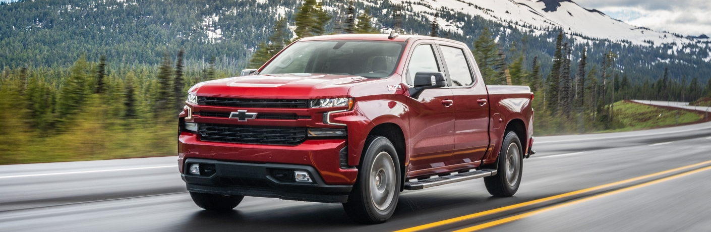 Red 2020 Chevy Silverado 1500 from front driver side angle on road in front of mountain