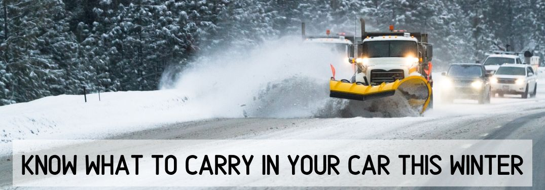 Snow plow on snowy road with car behind it and text below saying Know What To Carry in Your Car This Winter