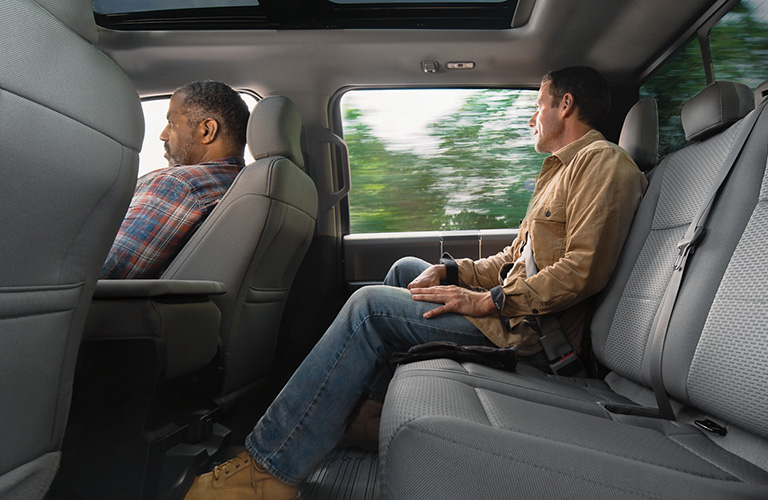 Man rides comfortably in the rear seat of a SuperCrew cab.