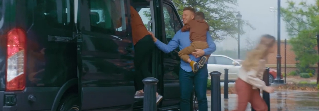 family getting out of the ford transit