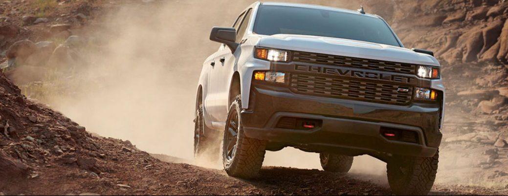 2020 Chevy Silverado rolls through a dusty off-road environment