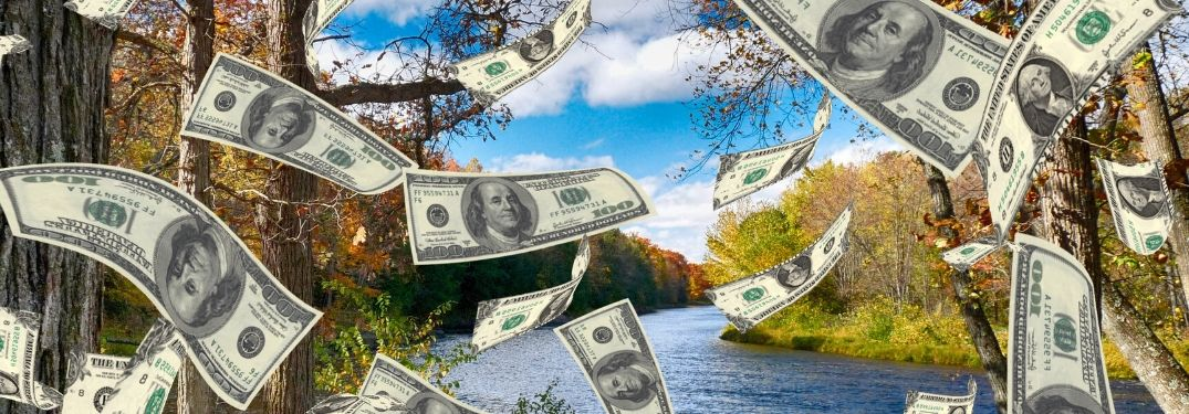 Money rains down over a tranquil Wisconsin nature scene