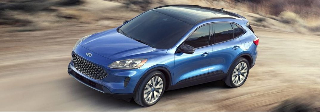 How does the Ford Escape Hybrid recharge its electric motor?