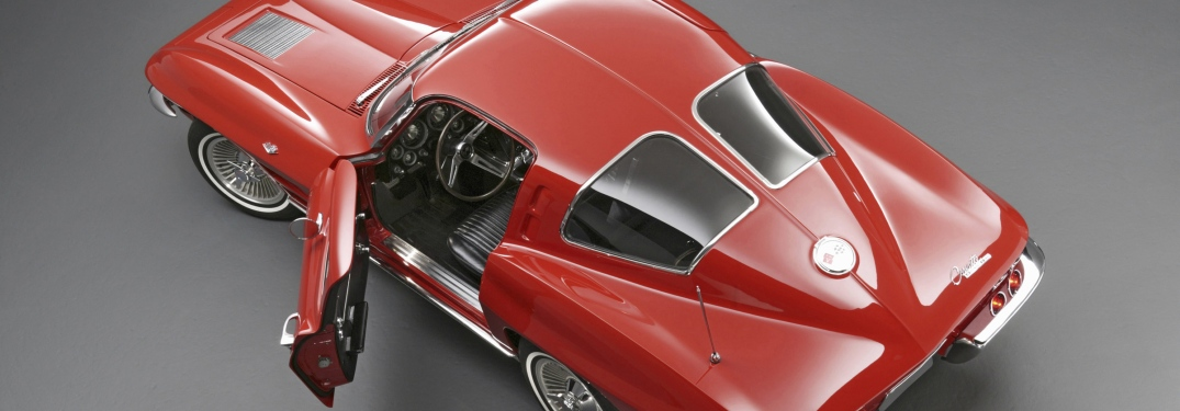 Top down view of a classic red Corvette with an open, inviting door