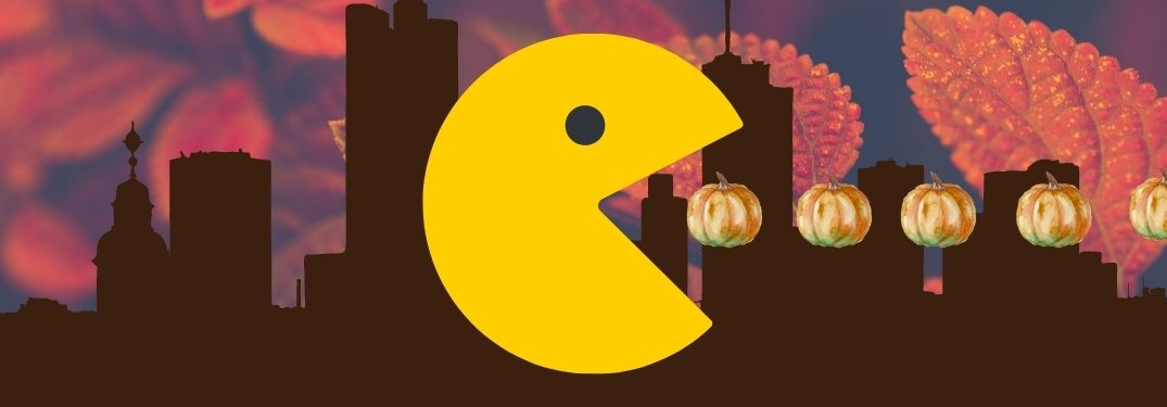 Pac-Man eats a line of oil-painted pumpkins with a city and autumn leaf backdrop