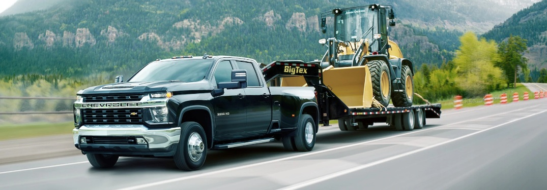 2021 Chevrolet HD truck pulling heavy machinery