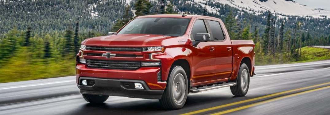 Red 2021 Chevy Silverado on highway