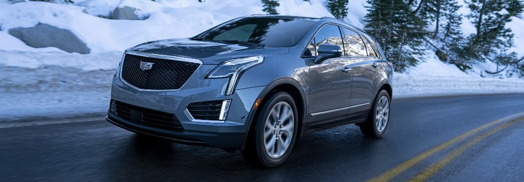 Front driver angle of a grey 2021 Cadillac XT5 driving in winter