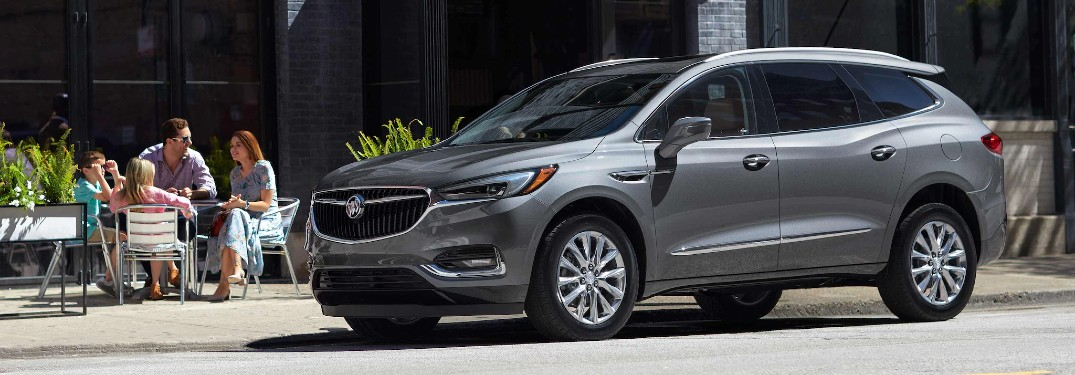 Front driver angle of a grey 2021 Buick Enclave