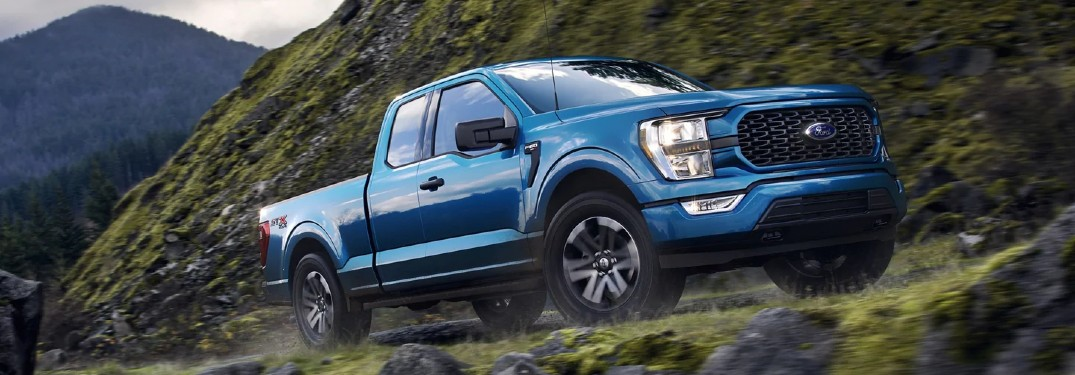 Front passenger angle of a blue 2021 Ford F-150