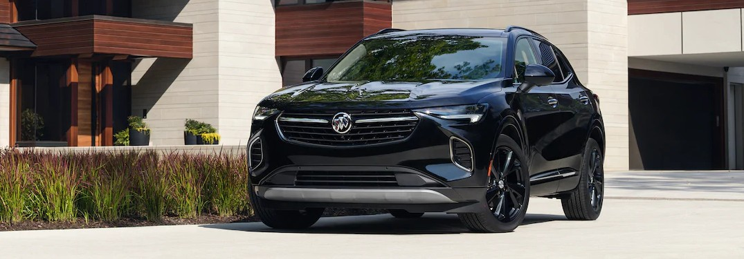 Front driver angle of a dark blue 2021 Buick Envision