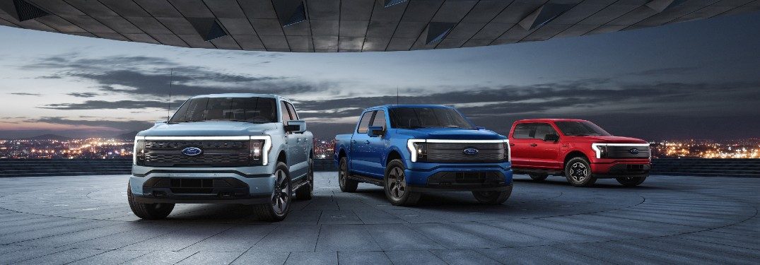 Three 2022 Ford F-150 Lightning vehicles parked next to each other