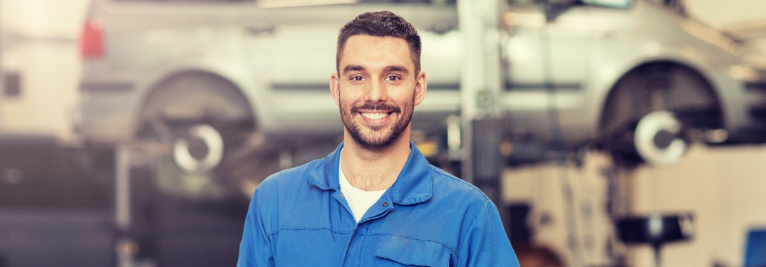 Happy mechanic in a vehicle shop