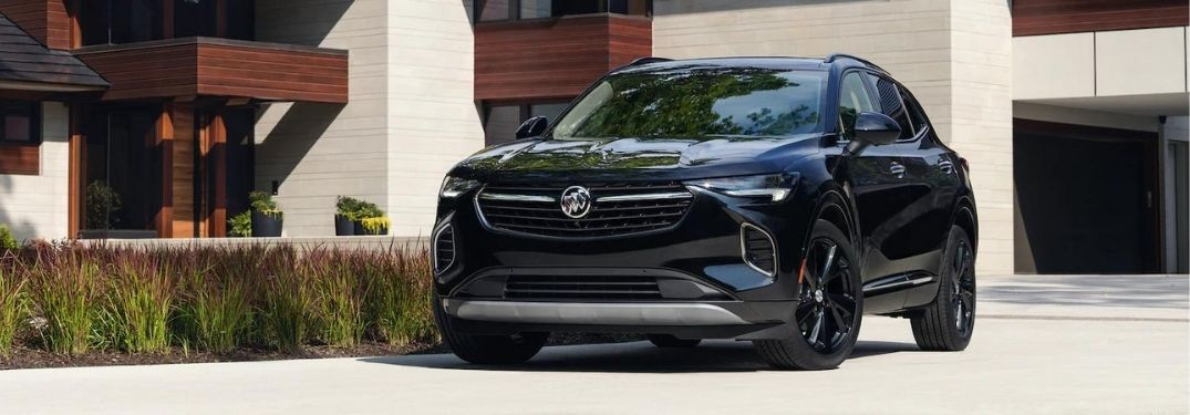 2021 Buick Envision parked by a house.