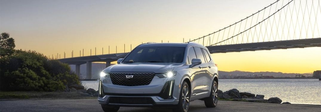 2021 Cadillac XT6 parked in front of a bridge
