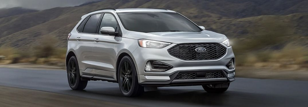 A silver 2021 Ford Edge on the road.