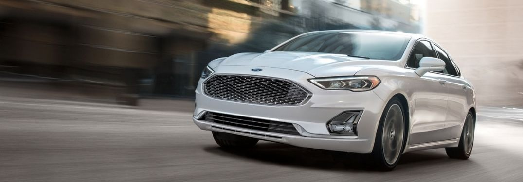 White 2020 Ford Fusion cruising on the road