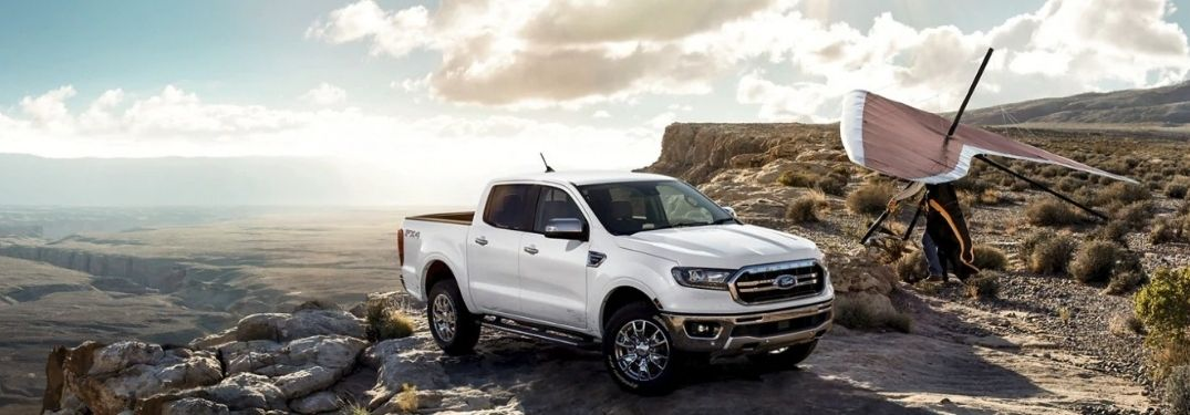 A white 2021 Ford Ranger parked on the edge of a rocky mountain.
