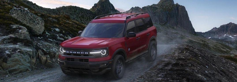 A 2021 Ford Bronco Sport driving down a mountain range.
