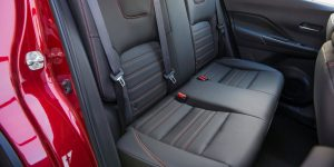2018 Nissan Kicks Side View of Rear Seats and Red Exterior