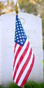 Small American Flag in Front of Grave