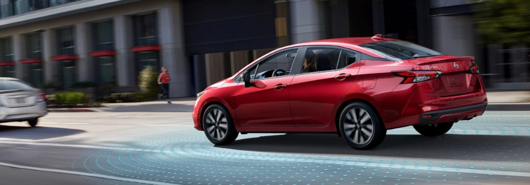 red 2020 Nissan Versa driving on street