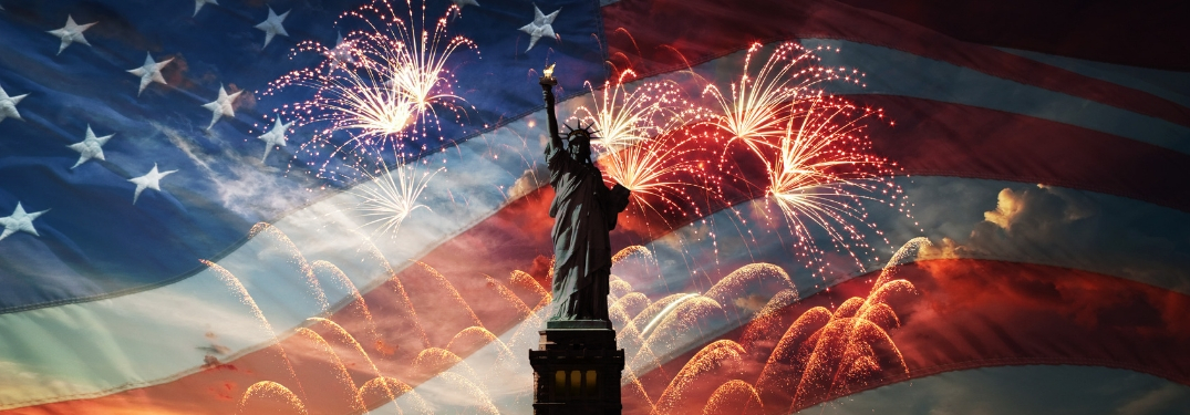 statute of liberty in front of american flag background