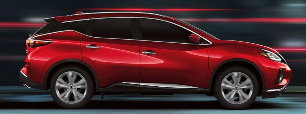 2020 Nissan Murano red paint facing right showing passenger doors surreal blurred background