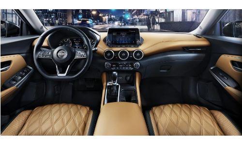 2020 Nissan Sentra interior shot over front headrests showing seats dashboard steering wheel