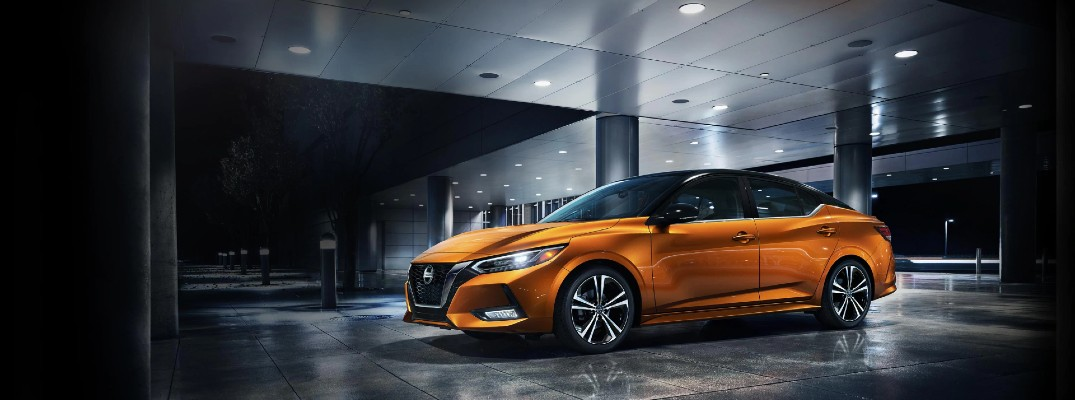 2020 Nissan Sentra orange paint parked inside building lit from above